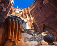 Ruined Buddha inside Wat Si Chum Royalty Free Stock Photography