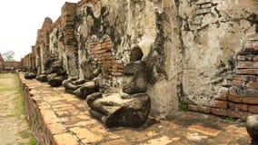 Ruined Buddha sitting at Ayutthaya. Seated Buddha statues remaining at Ayutthaya, Thailand Stock Photo