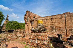 Ruined buddha statue and temple in Wat Mahathat Royalty Free Stock Image