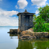 Ruined Buddhist temple on small island Royalty Free Stock Image