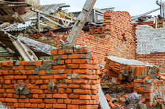 Ruined building. Destroyed industrial building constructed of red bricks on crisis time Stock Photos