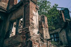 Ruined building, old ruins of brick house broken by war, earthquake or other natural disaster. Demolition building concept Stock Photos