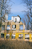 Ruined building. Old ruined school building ant blue sky Royalty Free Stock Image