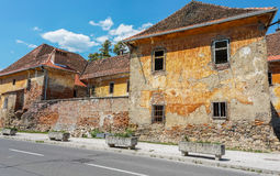 Ruined building. An old ruined building by the street Stock Image
