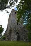S:t Lars Olofs kyrkoruin. The ruined building of St Lars Olaf church. A Viking church surrounded by Runic Stones stock photos