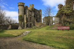 Ruined castle in Thurso, Scotland. Landscape of old fashioned ruined castle in the green park Royalty Free Stock Image