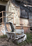 Ruined Chair Outside Burned Building Stock Images
