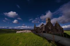 Ruined church in ireland in a field stock photo