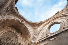 Ruined church without roof, Ischia, Italy. Ruined church without roof under blue cloudy sky, Ischia Porto, Bay of Naples, Italy Stock Images