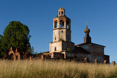 Ruined church in Russian village. Near tree Royalty Free Stock Images