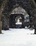 Ruined church in snowfall with doorway and arches in heptonstall Royalty Free Stock Photography