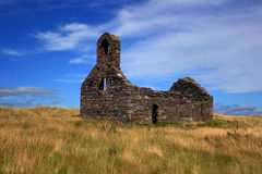Ruined church on a summer day. Taken on St. Michael's Island in the Isle of Man Royalty Free Stock Photo