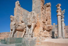 Ruined city Persepolis with Xerxes Gate. Persian ruined city Persepolis with Xerxes Gate (Gate of All Nations), Iran. Persepolis was a capital of the Achaemenid stock images