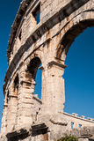 Ruined Colliseum in Pula, Croatia. Old ruined Colliseum in Pula, Croatia during the day with blue sky Royalty Free Stock Photography