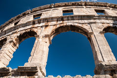 Ruined Colliseum in Pula, Croatia. Old ruined Colliseum in Pula, Croatia during the day with blue sky Royalty Free Stock Photo