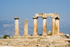 Ruined columns of ancient temple in corinth Royalty Free Stock Images