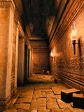 Ruined corridor. Old ruined corridor lit by torchlight Royalty Free Stock Photography