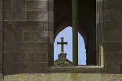 Ruined cross. Christian cross seen through window of ruined church royalty free stock images