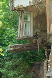 A collapsed floor in the room of a private house, fragment of the wall and window. Destruction of the foundation by groundwater. Ruined damaged building stock photo