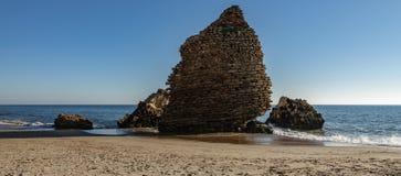 Ruined defense tower in the ocean shore. Ocean shore with old ruined defense tower royalty free stock photos