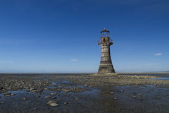 Ruined derelict lighthouse, space to top left. Whiteford Sands,. Whiteford Lighthouse is the only wave swept cast iron lighthouse in Britain. See here at low stock photography