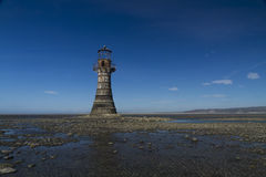 Ruined derelict lighthouse, space to top right. Whiteford Sands, Gower Peninsula, South Wales. Blue Sky. Whiteford Lighthouse is the only wave swept cast iron royalty free stock photo