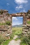 Ruined doorway. Looking towards neolithic standing stones, Machrie, Scotland stock photos