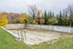 Ruined and Drained swimming pool 2. Ruined and Drained swimming pool in the nature Stock Photo