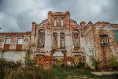Ruined facade of red brick industrial building in art nouveau style. Abandoned and destroyed sugar factory in Novopokrovka, Tambov region Stock Photos