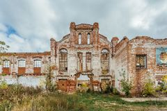 Ruined facade of red brick industrial building in art nouveau style. Abandoned and destroyed sugar factory in Novopokrovka, Tambov region Stock Photography