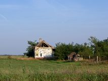 Ruined farmhouse. Abandoned dilapidated farmhouse on the edge of the field Royalty Free Stock Photography