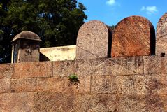 Fort battlement with corner doom. A ruined fort battlement and corner doom at Vellore fort is a large 16th-century fort situated in the Vellore city, in the royalty free stock photo
