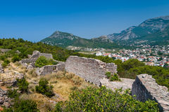 Ruined fortress walls and Sutomore town view from the hills stock images