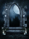 Ruined gate with candles and fern Stock Photos