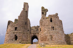 Ruined Gatehouse of Dunstanburgh Castle. On the Northumberland coast of England Royalty Free Stock Image