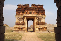 Ruined gateway, hampi. The gateway tower of Achutaraya temple in Hampi, which once stood 9 storeys tall. The gateway leads into the temple ruins built in the stock photos