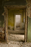 Ruined house. Interior of a ruined house with empty, deserted rooms stock photography