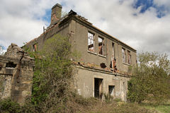 Ruined house. A ruined and abandoned house, roofless and becoming overgrown Royalty Free Stock Photos