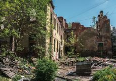 Ruined house building after war, earthquake, hurricane or other natural disaster. Toned royalty free stock photography