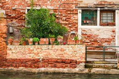 Ruined house on a canal in Venice stock photography