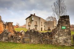 Ruined house destroyed by fire following the massacre of the ent Royalty Free Stock Photos