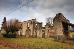 Ruined house destroyed by fire following the massacre of the ent Royalty Free Stock Photo