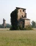 Ruined house in a field Stock Photography
