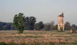 Ruined house in a field Royalty Free Stock Photos