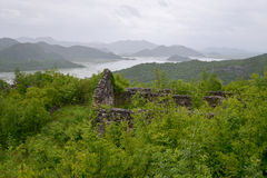 Ruined house on the hill. Ruined house on a hilltop with Skadar Lake view Royalty Free Stock Photo