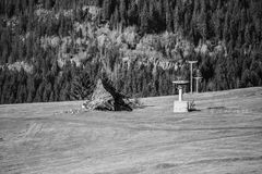 A ruined house on a mountain in black and white, with a neglecte. D zipper, for winter sports Royalty Free Stock Images
