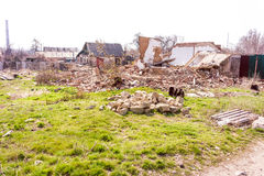 Ruined house. Old abandoned ruined house with green grass Royalty Free Stock Photos