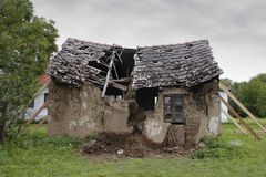 Ruined house. Propped and with broken roof Stock Images