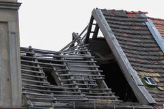 Ruined house with roof collapsed. Ruined house without a roof and walls severely damaged Stock Photography