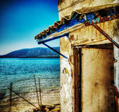 Ruined house by the shore in Sardinia Stock Images